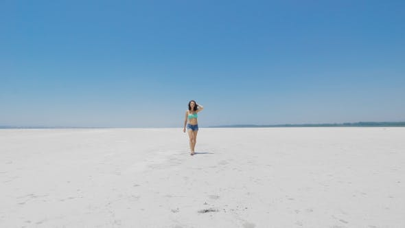 Thumbnail for A Woman Walking On Very White Salt Lake In Cyprus