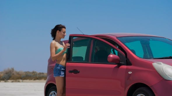 Thumbnail for A Beautiful Girl Driving Red Nissan Note At The Salt Lake.
