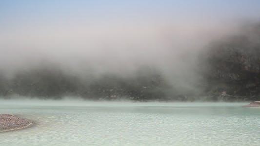 Cover Image for Fog Descending Over Lake Surface