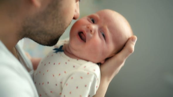 Thumbnail for Father Holding Newborn Baby Girl