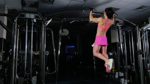 Thumbnail for Attractive Fitness Woman Pulls On The Bar In The Gym
