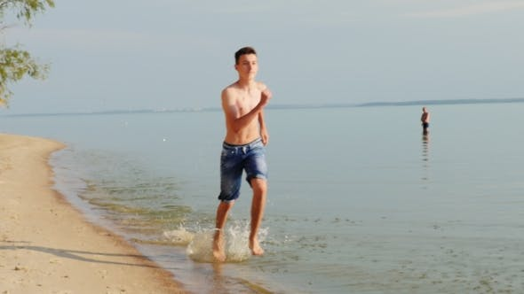 Thumbnail for Teen 15 Years Running On The Beach On The Water