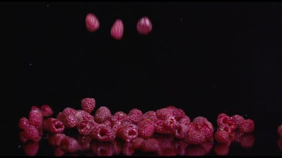 Cover Image for Fresh Raspberries Isolated On Black Background