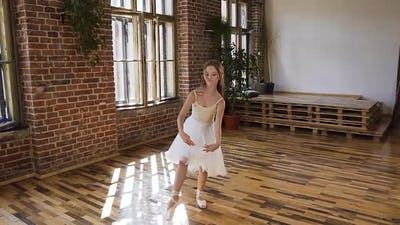 Young Ballet Dancer in white Dress and Ballet Shoes Performs Elements of Ballet