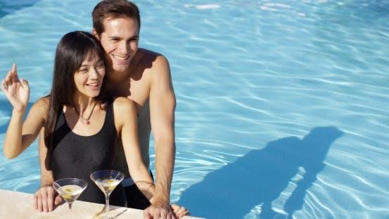 Thumbnail for Loving Couple Smooching At Swimming Pool