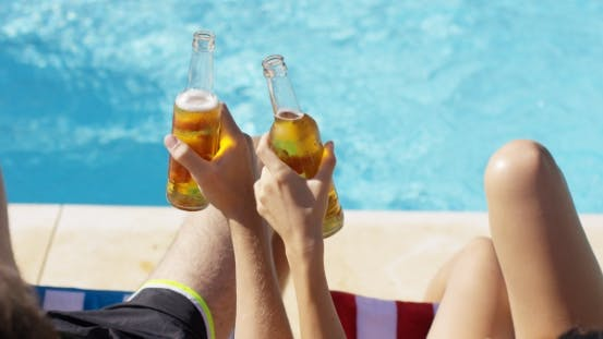 Thumbnail for Couple Relaxing At The Pool With Beers