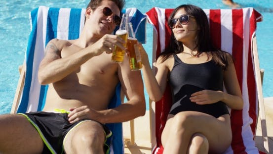 Thumbnail for Attractive Young Couple Enjoying a Beer