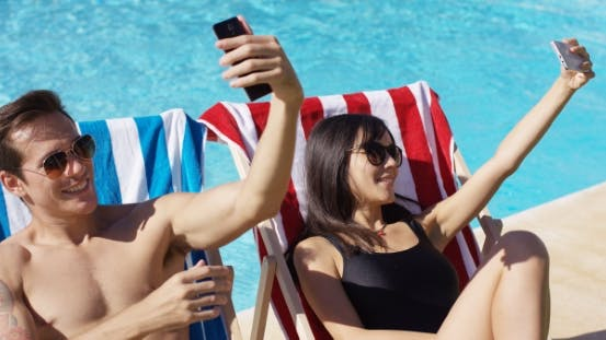 Thumbnail for Man And Woman Taking Self Portraits At Pool