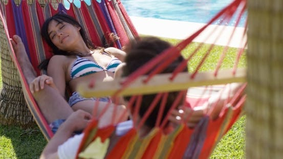 Thumbnail for Young Holiday Couple Relaxing In a Hammock