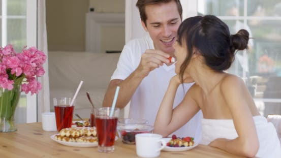 Thumbnail for Man Feeding His Wife Fruit At Breakfast