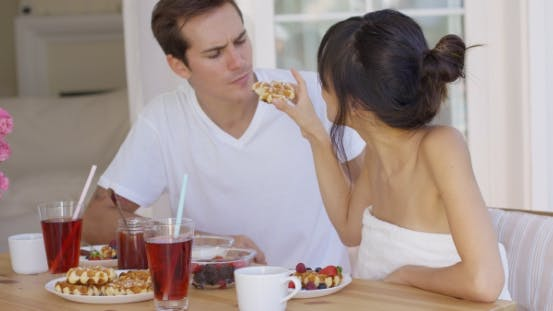 Thumbnail for Woman Trying To Feed Annoyed Man a Waffle