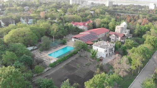 Hotel complex with swimming pool, aerial view.