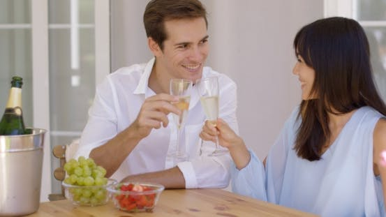 Thumbnail for Cheerful Couple Toasting Champagne