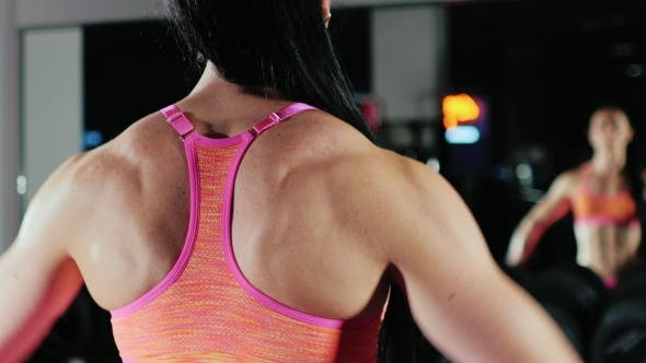 Thumbnail for Motivation And Commitment To The Sport: Athletic Woman Training In Gym. Female Bodybuilding