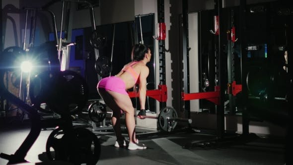 Thumbnail for Motivation And Commitment To The Sport: Athletic Woman Training In a Hall In Gym. Female