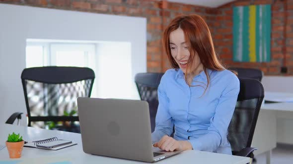 Thumbnail for Excited Business Woman Enjoy Good News Seen on Laptop Screen in Office