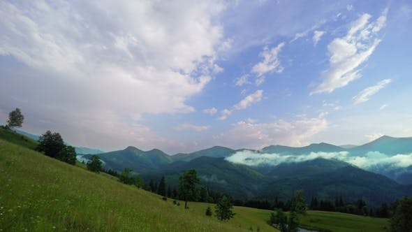Thumbnail for Sunset in the Mountain with Clouds and Fog.