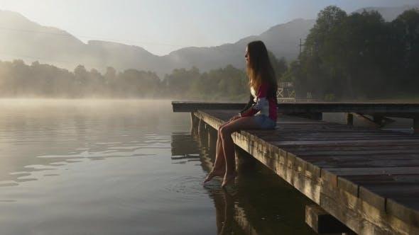 Thumbnail for Pensive Woman On Pier Of Mountain Lake