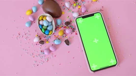 Thumbnail for Phone With Green Screen Lying Near Decorations, Mock-Up. Easter, junk-food