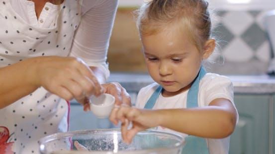 Thumbnail for Cute Little Girl Adding Salt To a Baking Mixture