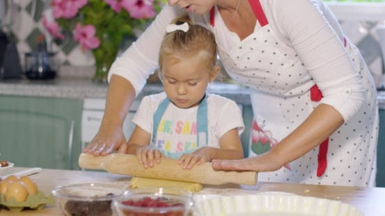 Thumbnail for Mother Rolling Out Pastry With a Little Helper