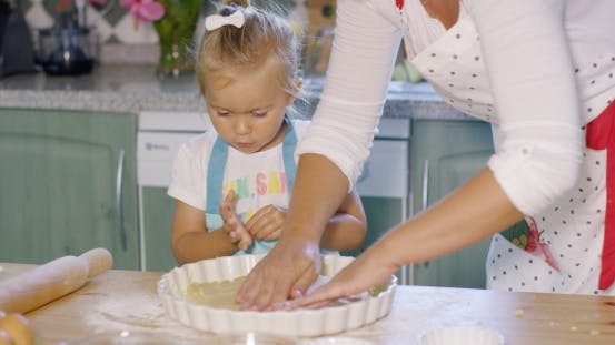 Thumbnail for Mother And Daughter Baking a Homemade Pie