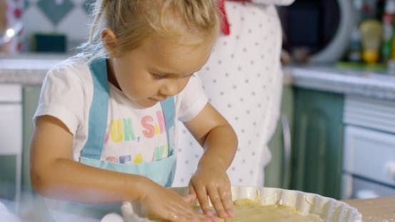 Thumbnail for Adorable Little Girl Baking a Tart With Her Mother