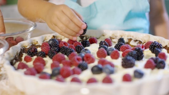 Thumbnail for Little Girl Finishing Off a Homemade Berry Pie