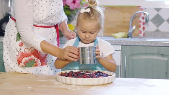 Thumbnail for Mother Teaching Her Cute Little Daughter To Bake