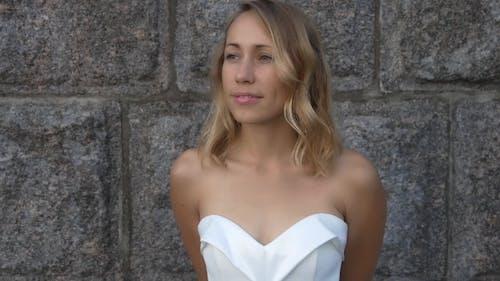 Beautiful Woman In a White Dress
