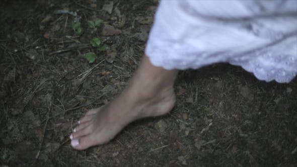 Bare Feet Of A Young Woman