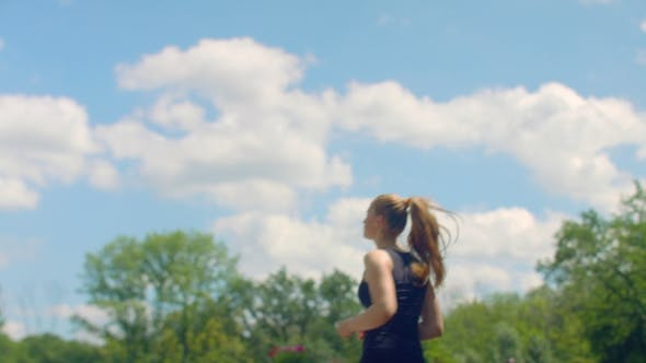 Thumbnail for FItness Woman Running In  At Background Of Blue Sky With Clouds