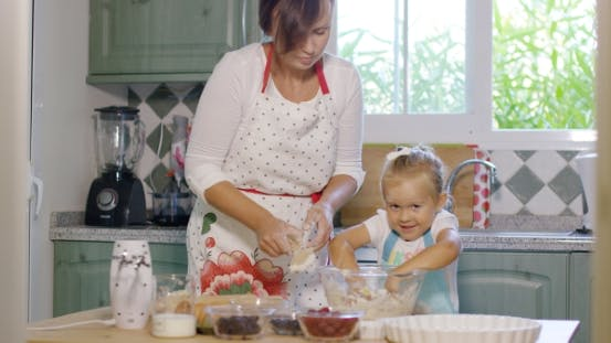Thumbnail for Happy Little Girl Mixing The Dough For a Pie