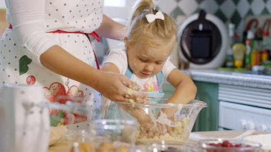Thumbnail for Cute Little Girl Kneading Baking Ingredients