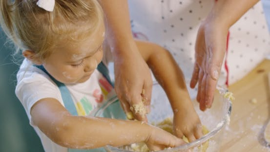 Thumbnail for Little Girl Helping To Knead The Pastry Dough
