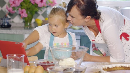Thumbnail for Mother And Daughter Checking a Baking Recipe