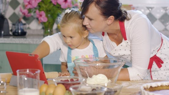Thumbnail for Mother And Her Cute Young Daughter In The Kitchen