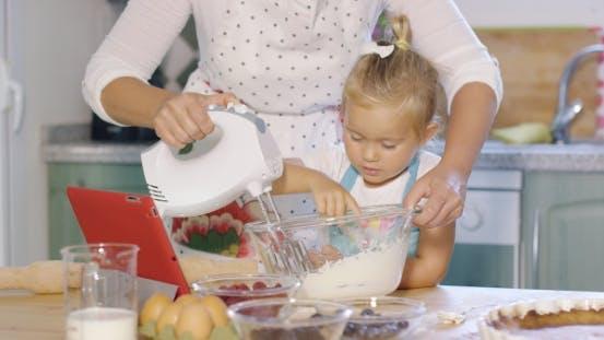 Thumbnail for Cute Little Kitchen Helper Helping Her Mum