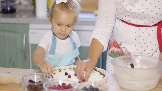 Thumbnail for Little Girl Watching The Baking With Anticipation