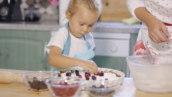 Thumbnail for Young Mother Watching Her Little Daughter Baking