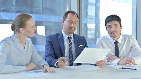 Thumbnail for Executive Business People Discussing Documents at Work