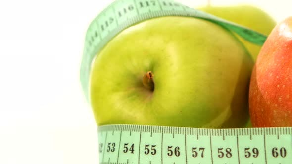 Thumbnail for Green, Fresh Apple with Measuring Tape on White, Rotation, Close Up