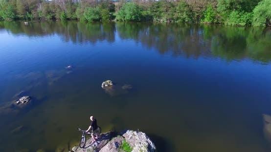 Thumbnail for Cyclist Near River