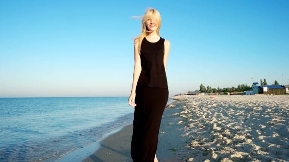 Cover Image for Romantic Girl Walking The Seashore.
