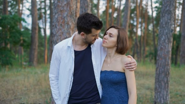 Thumbnail for Start a Romantic Relationship. Attractive Man And Woman Strolling Together In The Woods.
