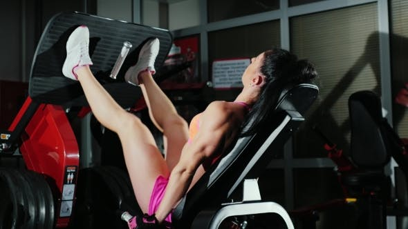 Thumbnail for Athletic Woman Trains Muscles Of The Legs In The Gym