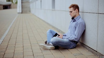 Sad Young Man With Empty Wallet. No Money