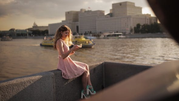 Cover Image for Beautiful Girl On The Waterfront With a Book In Their Hands