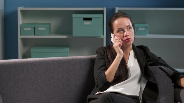 Thumbnail for Woman Talking By Phone In Office
