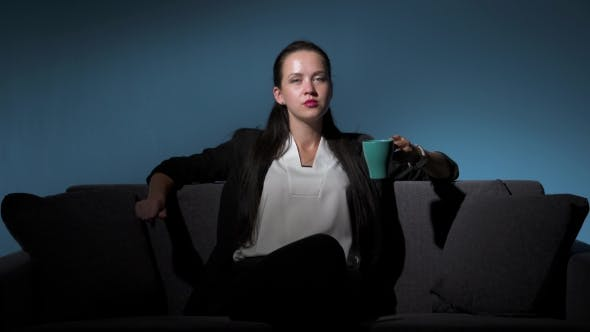 Thumbnail for Arrogant Businesswoman In Suit Drinking Coffee
